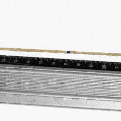 Put the piece of string along the ruler and pull it tight.